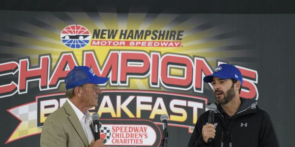 Seven-time NASCAR Cup Series champion Jimmie Johnson speaks to fans during the July 14 SCC Champions Breakfast, which benefits the Children's Hospital at Dartmouth-Hitchcock.