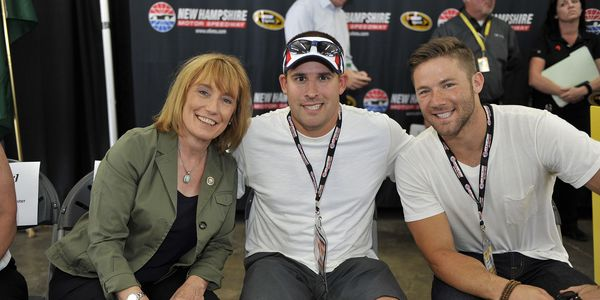 Josh McDaniels (center) was a race dignitary in 2014 with then-Governor Maggie Hassan and Patriots WR Julian Edelman.