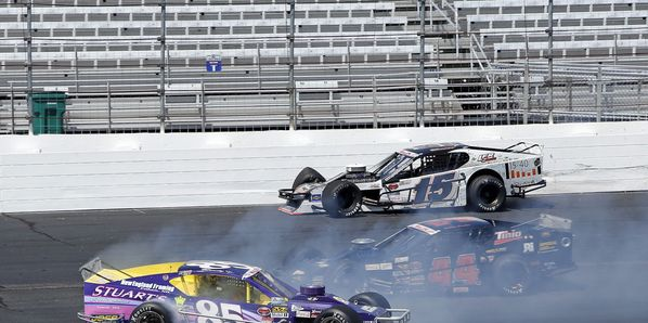 Whelen Modified Tour driver Bobby Santos (44) races between Todd Szegedy and Woody Pitkat to win Friday's All-Star Shootout at New Hampshire Motor Speedway.