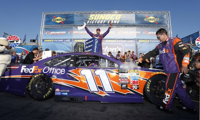 Denny Hamlin celebrates his third-career win at New Hampshire Motor Speedway following his win in Sunday's Overton's 301.