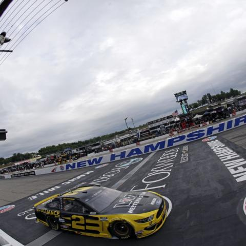 """Brad Keselowski crossing the Granite Stripe at New Hampshire Motor Speedway as he took the checkered flag for the NASCAR Cup Series Foxwoods Resort Casino 301 on Aug. 2, 2020 for his second win at """"The Magic Mile."""""""