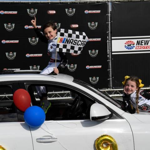 Jon and Abby McDonagh celebrate in victory lane at New Hampshire Motor Speedway after participating in Laps for Charity to benefit the New Hampshire Chapter of Speedway Children's Charities on May 14, 2021.