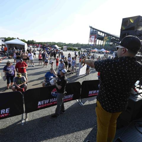 Jose Castillo (right) auctioning off items during the Wicked Good Live Auction to benefit the New Hampshire Chapter of Speedway Children's Charities Friday, July 16 at New Hampshire Motor Speedway.