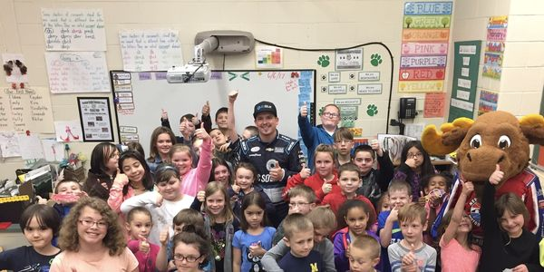 Brennan Poole visited Woodland Heights Elementary School on Tuesday. The Laconia, N.H., school was the winner of NHMS' inaugural Speeding to Read program.
