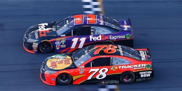 Denny Hamlin takes the checkered flag ahead of Martin Truex Jr. to win the Daytona 500 by .010 seconds on Feb. 21.