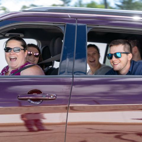 """A local family driving their vehicle onto """"The Magic Mile"""" during the June 13, 2020 Merrimack Valley High School graduation at New Hampshire Motor Speedway."""
