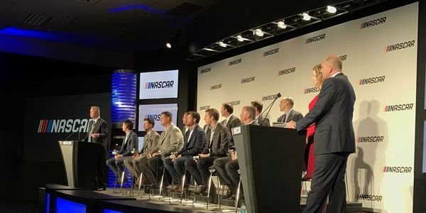 A panel of former and current drivers, as well as track promoters and team representatives sit on the stage Monday night in Charlotte, N.C.