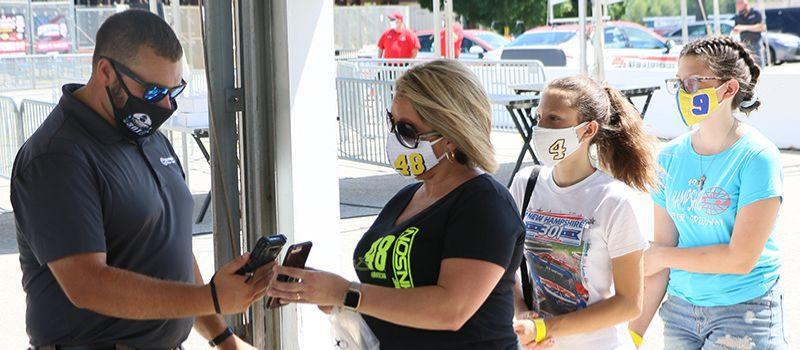 "Nelly Roache and her daughters Jocelyn and Ashlee go through a mobile ticket scanning station during a special media ""Journey of the Fan"" event on Friday, July 31, 2020. Digital tickets are part of New Hampshire Motor Speedway's new safety protocols put in place ahead of Sunday's Foxwoods Resort Casino 301 NASCAR Cup Series race to limit person-to-person contact."