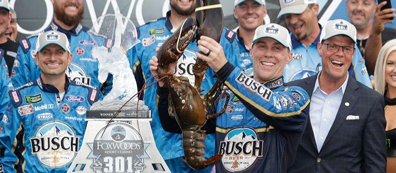 2014 NASCAR Cup Series champion Kevin Harvick earned his third of four New Hampshire Motor Speedway victories on July 22, 2018 and holds up Loudon the Lobster after taking the checkered flag in the Foxwoods Resort Casino 301.