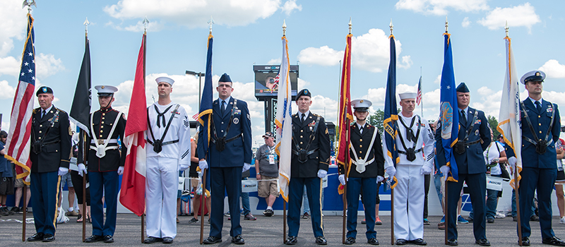 Military members during pre-race ceremonies at New Hampshire Motor Speedway in July 2017
