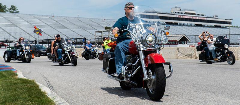 """Riders take to the 1.6-mile road course at New Hampshire Motor Speedway during the Mae West Memorial """"For the Love of Pets"""" Ride for the Humane Society on June 10, 2019."""