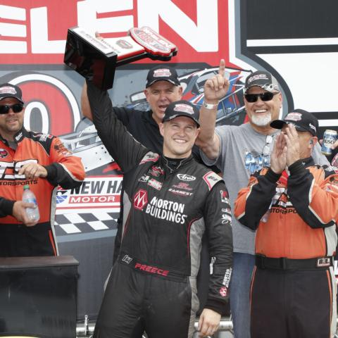 Ryan Preece (center) celebrates in victory lane at New Hampshire Motor Speedway Saturday after earning his first NASCAR Whelen Modified Tour points win at his home track at the Whelen 100.