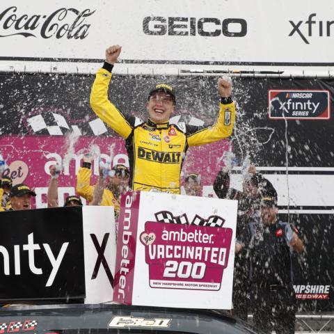 """Christopher Bell celebrates in victory lane Saturday after earning his third NASCAR Xfinity Series win at New Hampshire Motor Speedway after his third NXS start at """"The Magic Mile."""""""
