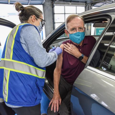 Jim Bolt receiving the COVID-19 vaccine during a mass vaccination clinic held at Charlotte Motor Speedway (sister track to New Hampshire Motor Speedway) on Feb. 11, 2021.