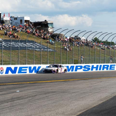 """NASCAR Cup Series driver Denny Hamlin races down the backstretch of """"The Magic Mile"""" during the July 21, 2019 Foxwoods Resort Casino 301 at New Hampshire Motor Speedway."""