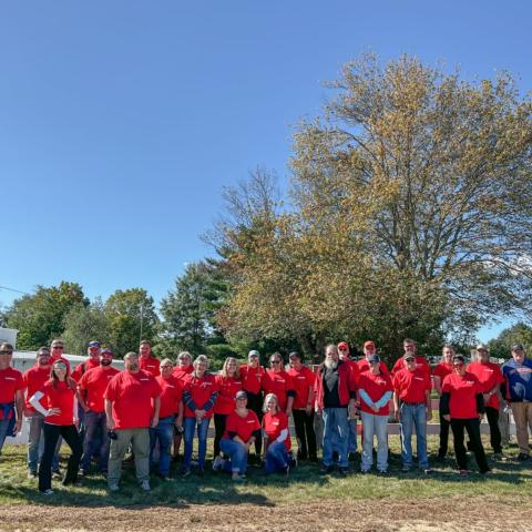 New Hampshire Motor Speedway staff members spent Wednesday morning scraping and repainting the fence at Loudon, N.H.'s oldest town cemetery for the third annual Speedway Cares Day.