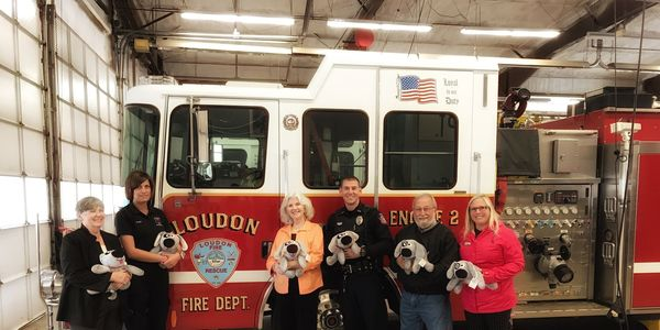 "Fifty ""Trouble the Dog"" stuffed animals were delivered to the Loudon Police and Fire departments on Thursday."
