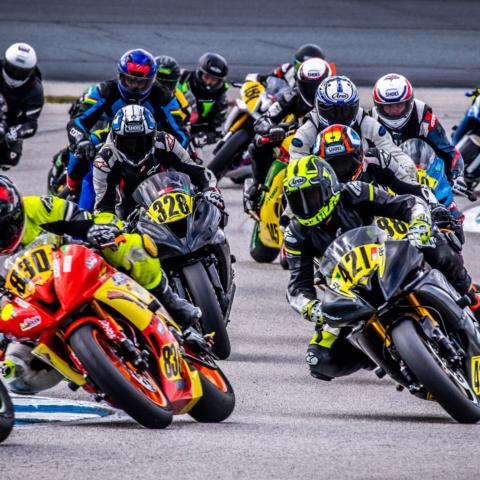 Northeast Motorcycle Road Racing riders in turn one of New Hampshire Motor Speedway's 1.6-mile full road course.